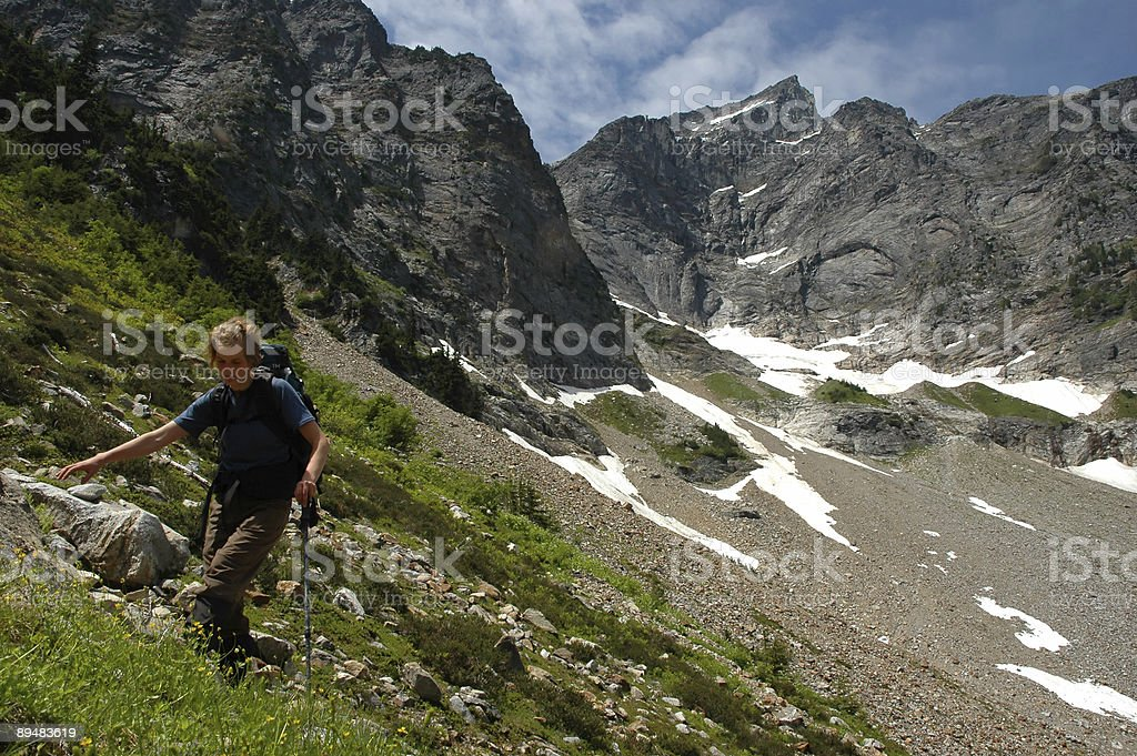 Woman hiking in backcountry royalty-free stock photo