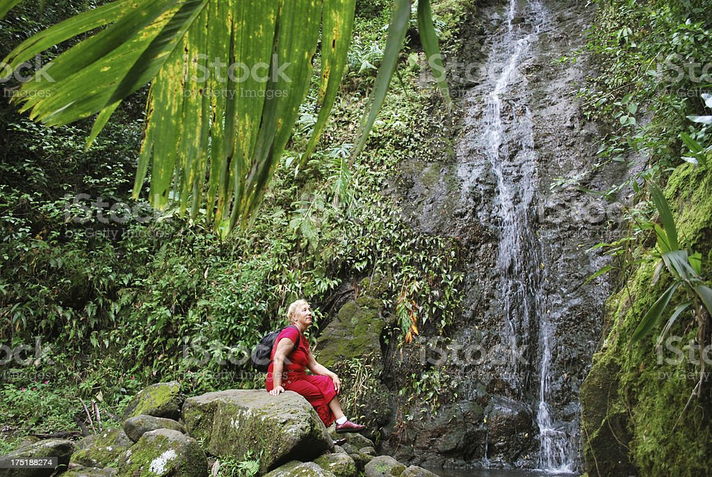 Woman hiking in Hawaii Islands stock photo