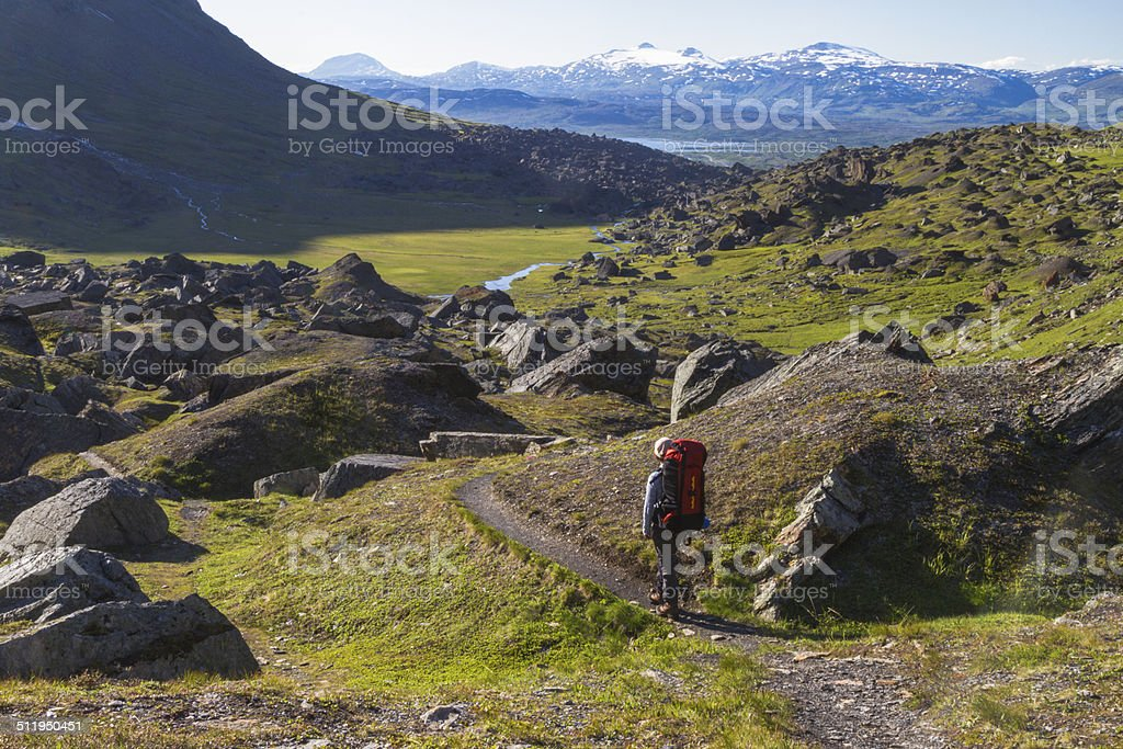 Woman hiking in mountains area in Sweden stock photo