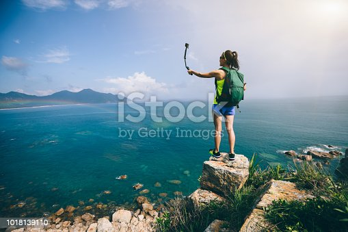 Woman Hiking In Seaside Taking A Selfie