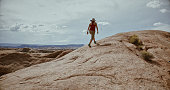 Woman hiking in the majestic desert landscapes of South West USA: outdoors adventures