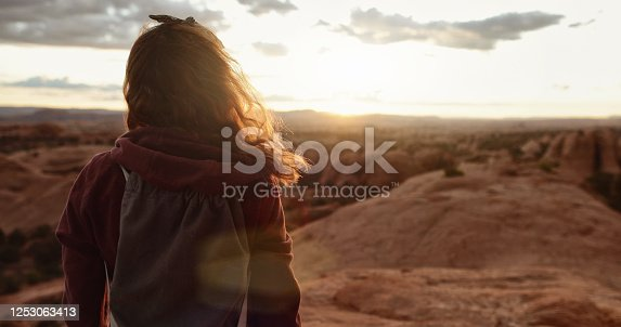 istock Woman hiking in the majestic desert landscapes of South West USA: outdoors adventures 1253063413