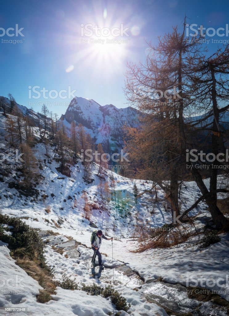 Italy. Piedmont. Alps. Monte Rosa Massif. Woman hiking on a mountain...
