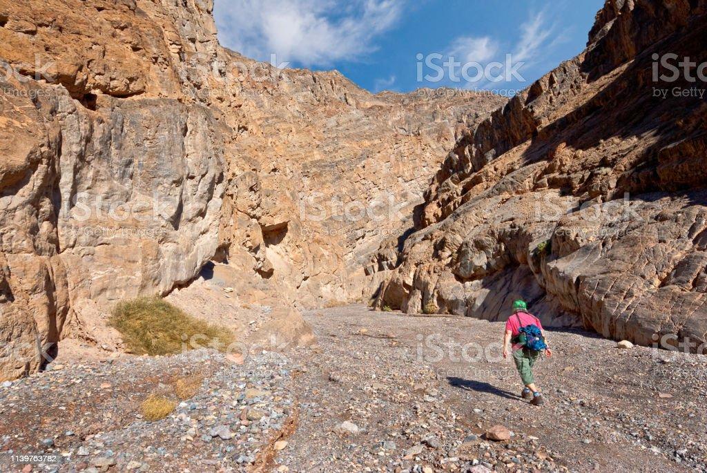 Woman Hiking in Titus Canyon stock photo