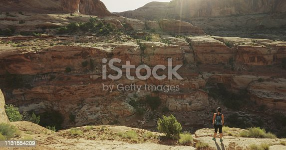 Woman hiking in Arches National Park, near Moab