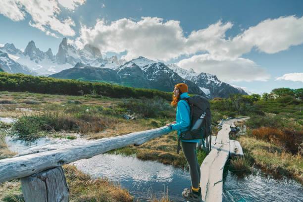 Woman hiking near  Fitz Roy mountain in Patagonia stock photo