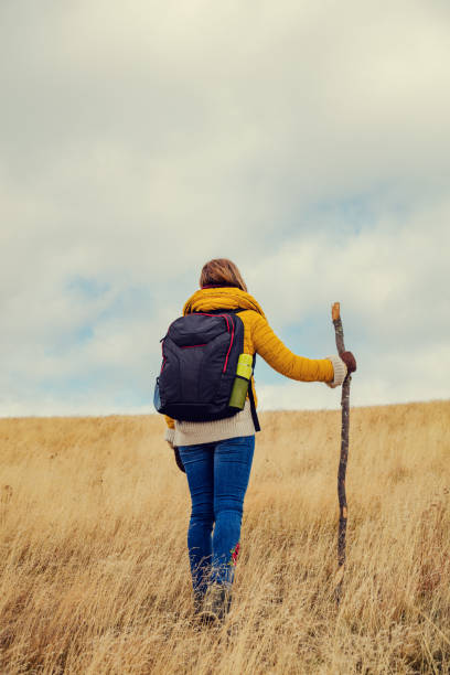 Woman hiking on a empty mountain meadow. stock photo
