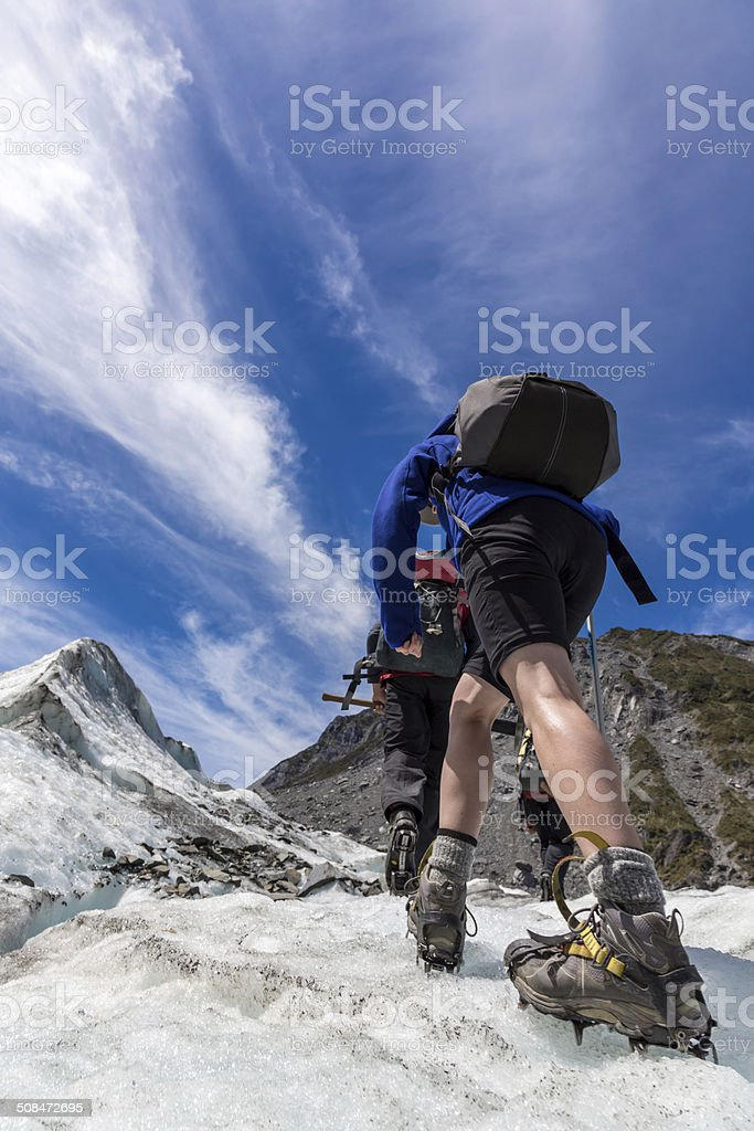 Woman hiking on Fox Glacier stock photo