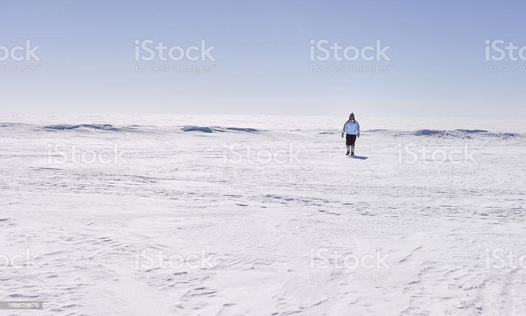 Woman Hiking on Great Slave Lake, Northwest Territories, Canada royalty-free stock photo
