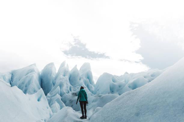 Woman hiking on Perito Moreno glacier stock photo