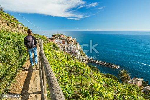istock Woman hiking on the path in vineyard near Manarola village. Cinque Terre. Liguria, Italy. 930748064