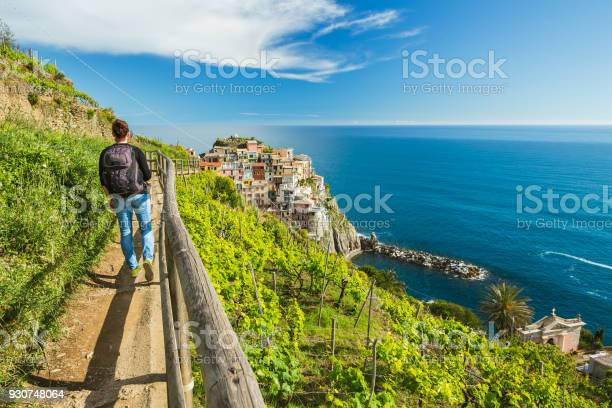 Woman Hiking On The Path In Vineyard Near Manarola Village Cinque Terre Liguria Italy Stock Photo - Download Image Now