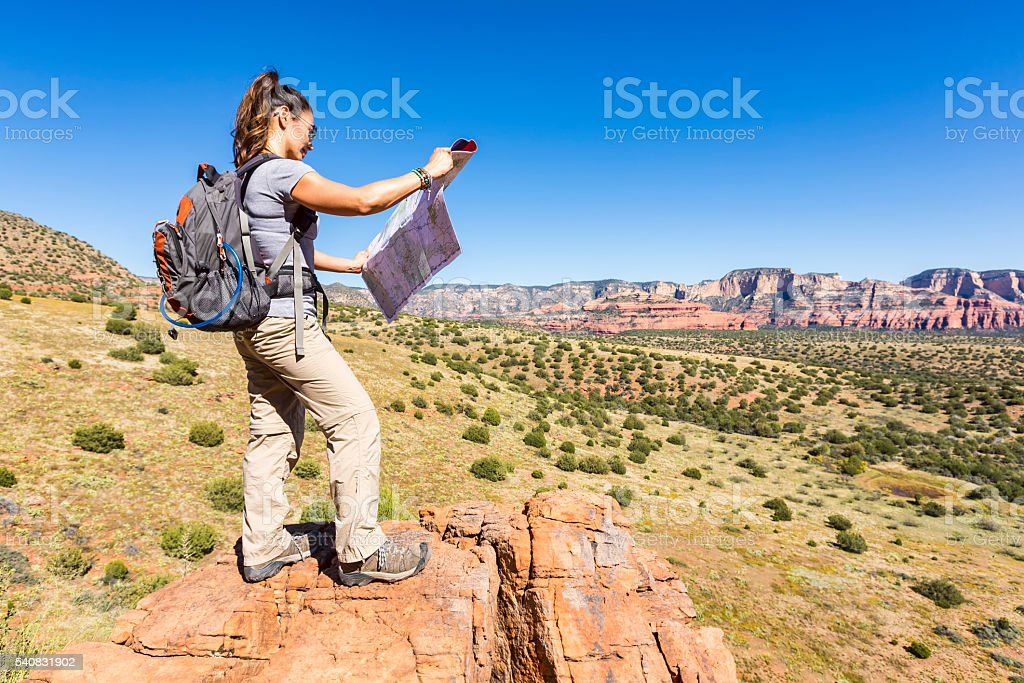 Woman Hiking Outdoors Determines Her Location stock photo