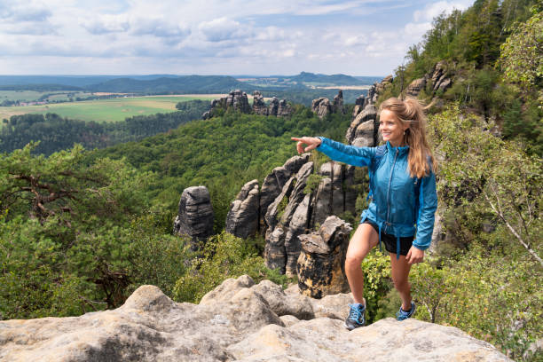 Woman Hiking, Saxon Switzerland, Elbe Sandstone Mountains, Germany stock photo