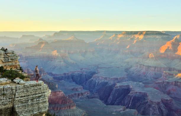 Woman Hiking South Rim Grand Canyon HDR photo stock photo