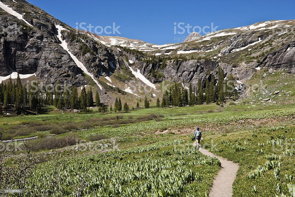 Woman Hiking to Upper Ice Lakes Basin royalty-free stock photo