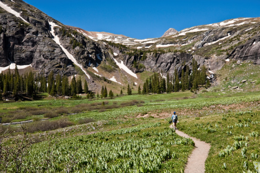 Woman Hiking To Upper Ice Lakes Basin Stock Photo - Download Image Now