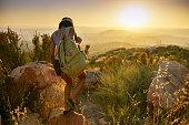 istock woman hiking trail near san diego california 849486960
