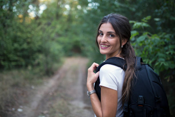 Woman Hiking Trekking with Backpack stock photo