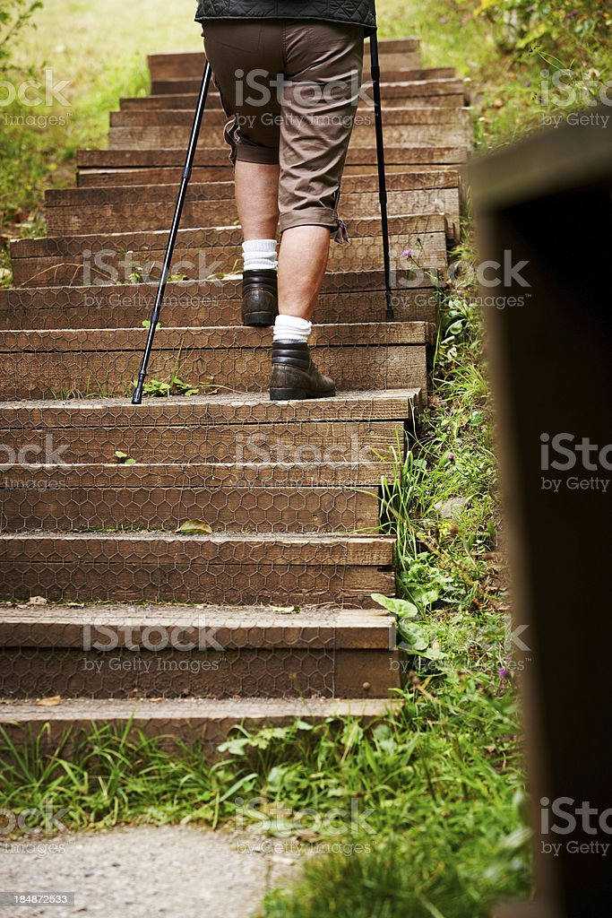 Woman Hiking Up Steps royalty-free stock photo