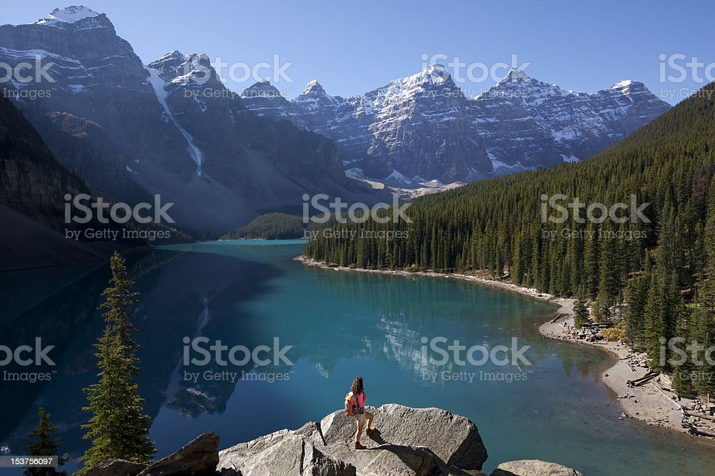 Woman Hiking With Backpack at Moraine Lake, Alberta, Canada stock photo