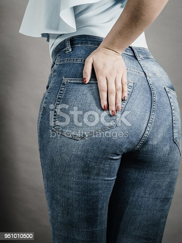 istock Woman hips buttocks in jeans clothing 951010500