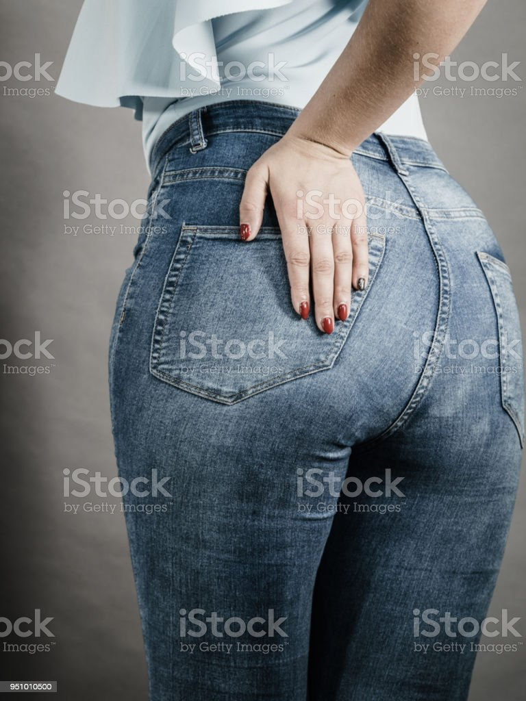 Woman hips buttocks in jeans clothing stock photo