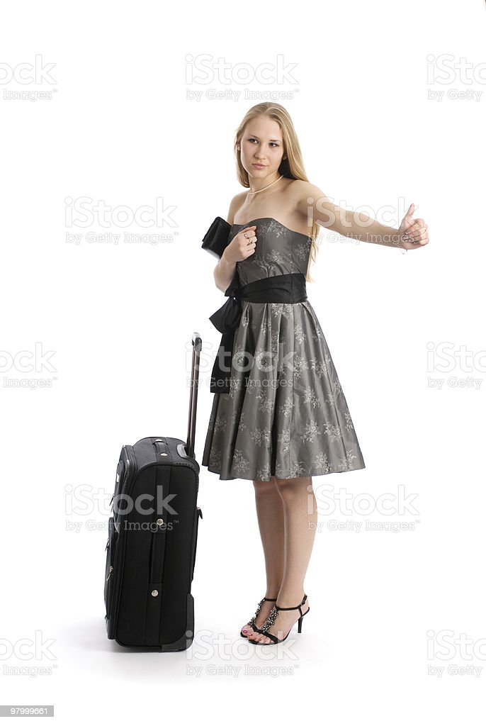 woman hitch hiking with suitcase royalty-free stock photo