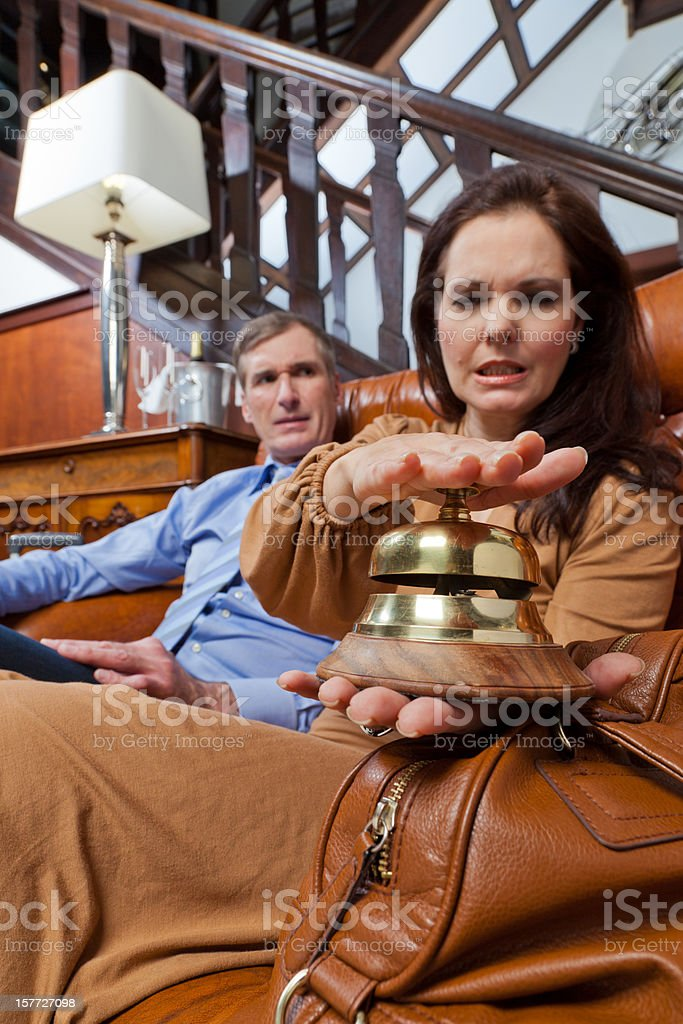 Woman hitting bell stock photo