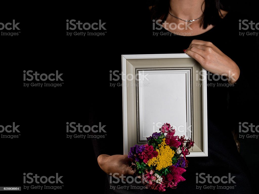 woman hold blank mourning frame with flower stock photo