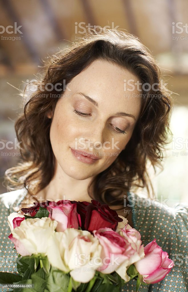 Woman hold bunch of flowers, close-up royalty free stockfoto