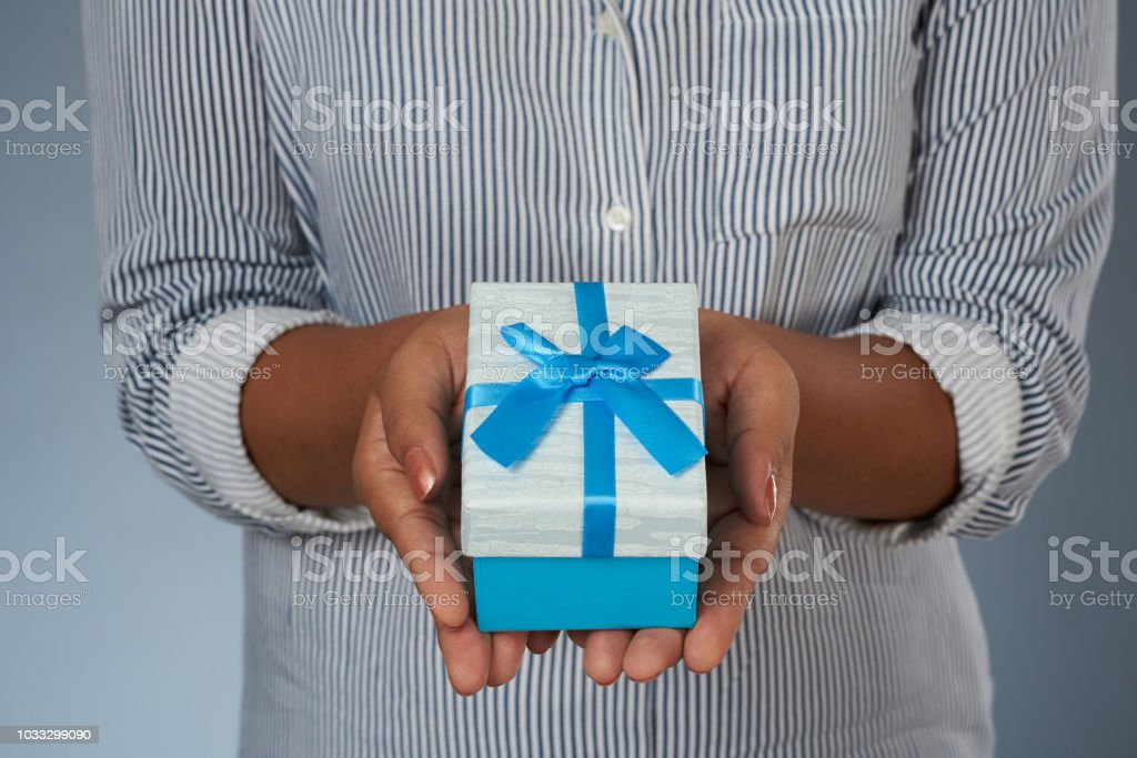 Woman hold gift box stock photo