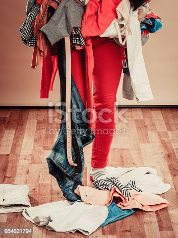 460589747 istock photo Woman hold lot of colorful clothes. 654631794