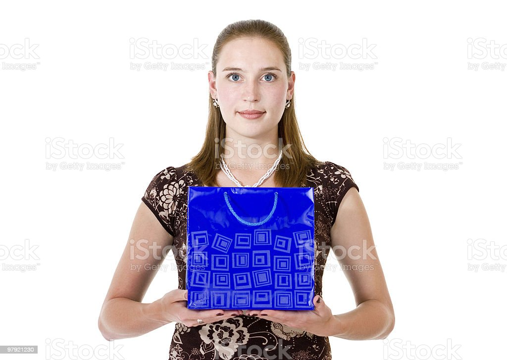 woman hold on palms blue bag with gift royalty-free stock photo