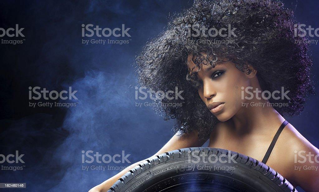 woman holdig car wheel royalty-free stock photo