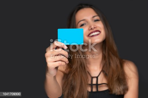Woman holding a bank card in her hand