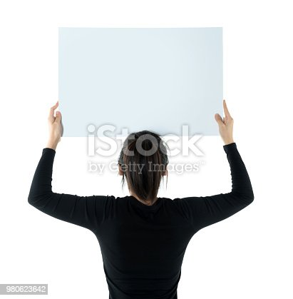 istock Woman holding a blank board on white background 980623642