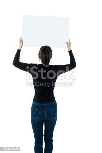 istock Woman holding a blank board on white background 980623656