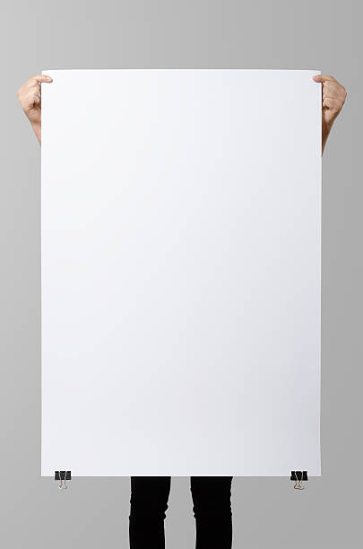 woman holding a blank poster, square 70x100, mock up. - poster stock pictures, royalty-free photos & images