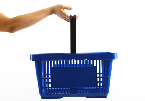 A woman holding a blue shopping basket