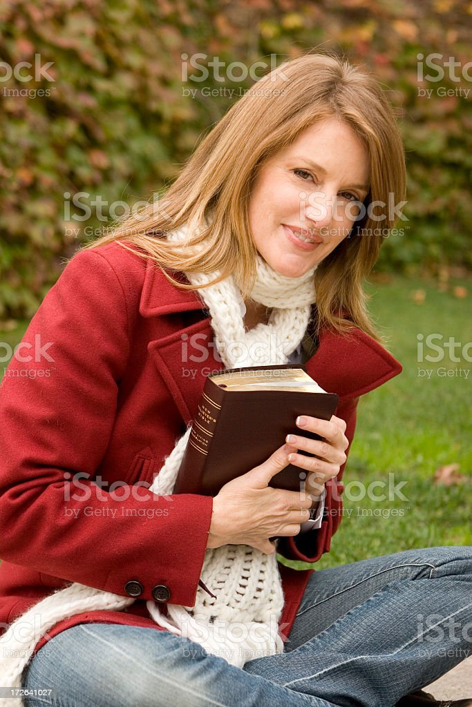 Woman holding a book royalty-free stock photo