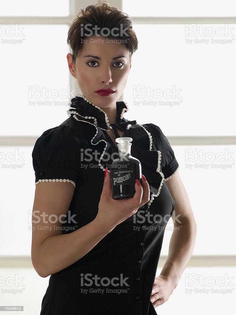 Woman holding a bottle of poison royalty-free stock photo