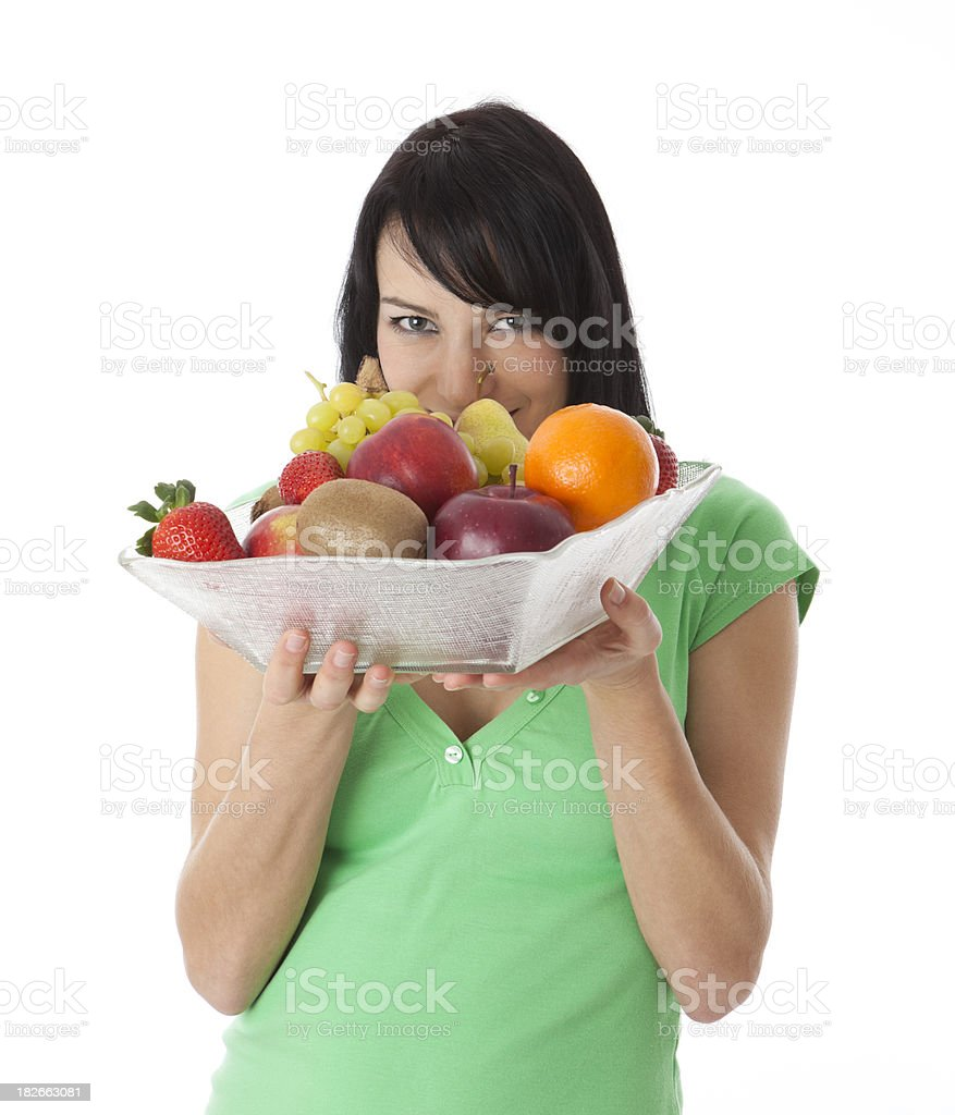 Woman holding a bowl with fresh fruit royalty-free stock photo