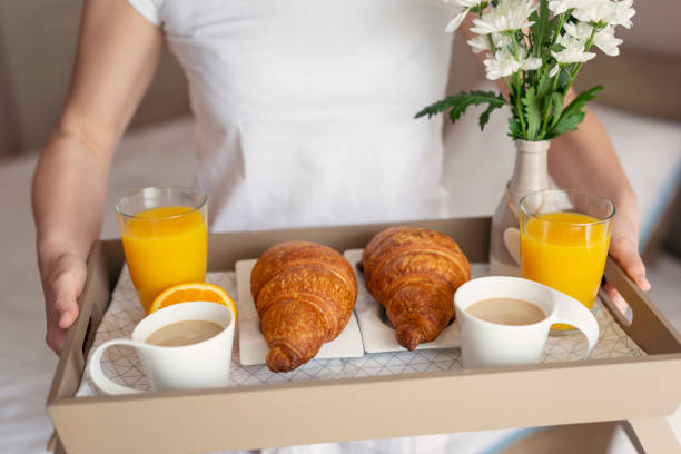 Woman holding a breakfast stock photo
