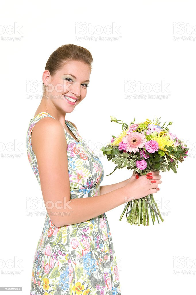 Woman holding a bunch of flowers 免版稅 stock photo
