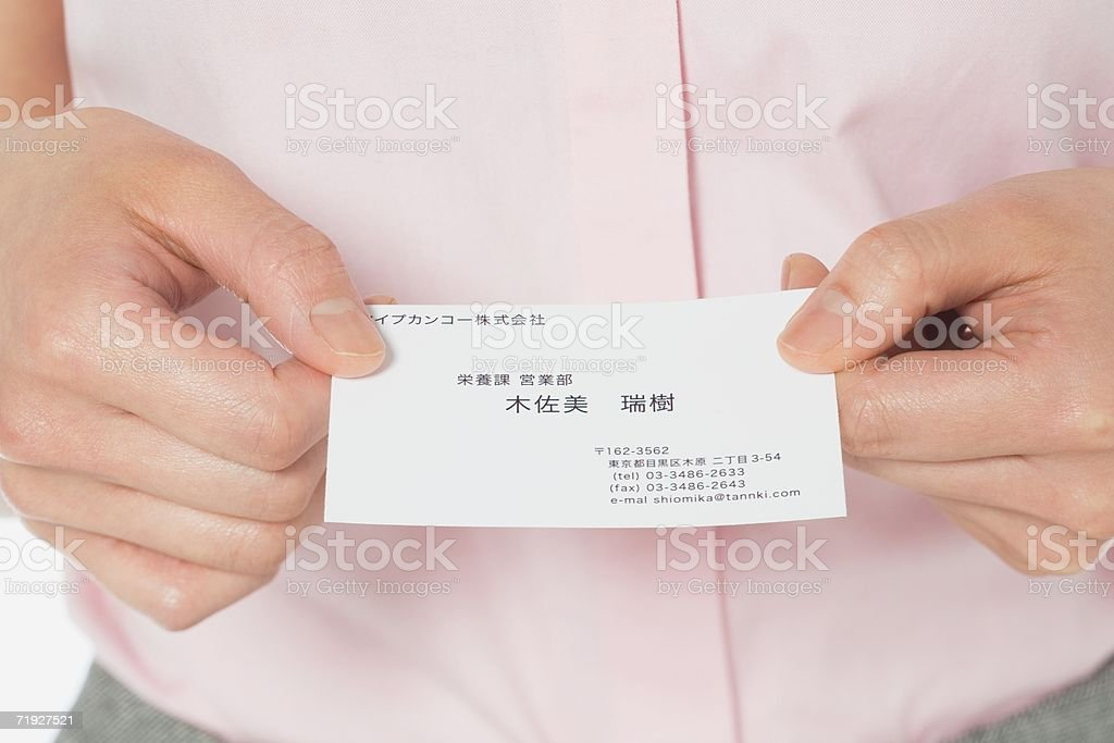 Woman holding a business card royalty-free stock photo