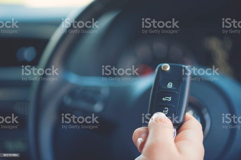 Woman holding a car key. stock photo