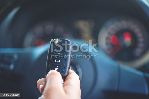 539841066 istock photo Woman holding a car key. 922707962
