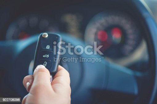 539841066 istock photo Woman holding a car key. 922708098