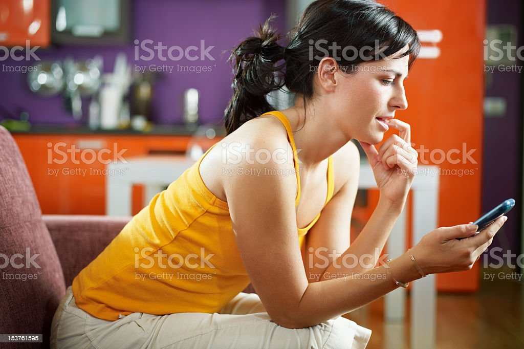 A woman holding a cell phone in her hand stock photo